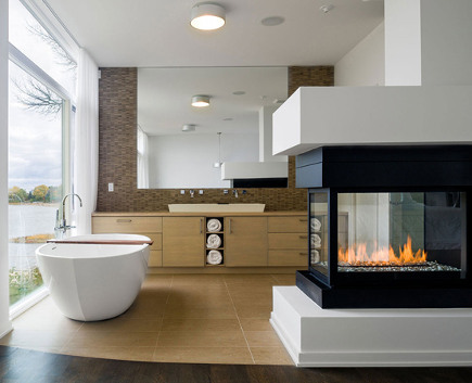 Bathroom Fireplace   3 Sided Vented Fireplace In Contemporary Bathroom With  River View   Freshpalace Via