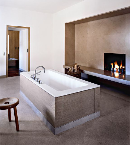 bathroom fireplace - master bath with fireplace and marble floor in renovated French chateau - elledecor via atticmag