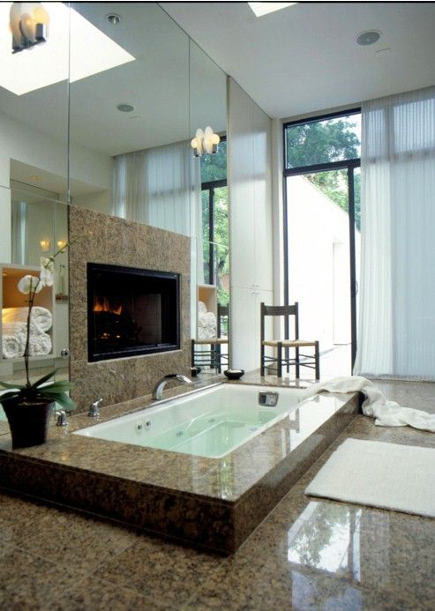 bathroom fireplace - brown granite bath with fireplace above the tub - ele.ro via atticmag