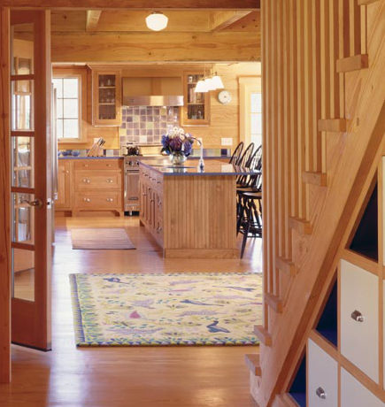 view into the kitchen of a Massachusetts beach house with blue painted furniture - hutker architects via atticmag