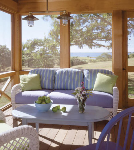blue painted furniture - white wicker settee with blue upholstery in a Massachusetts beach house - hutker architects via atticmag