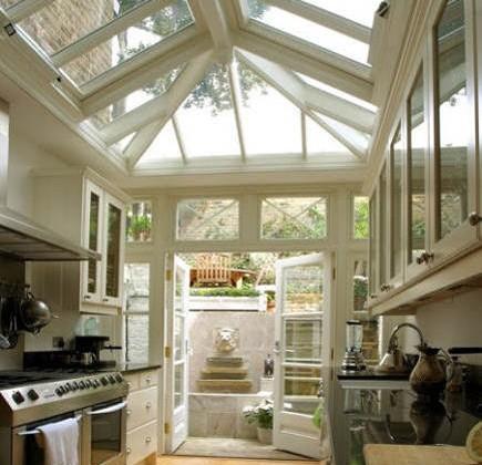galley conservatory kitchen opening onto backyard - reneefinberg via atticmag