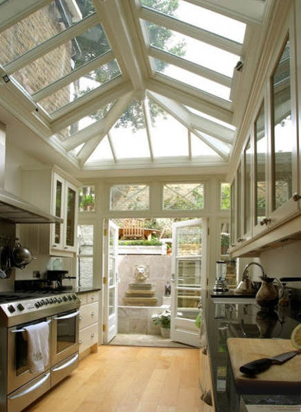 galley conservatory kitchen opening onto backyard - reneefinberg via atticmag