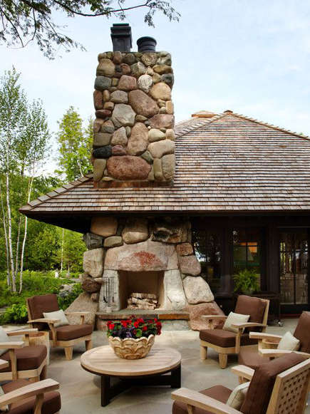 outdoor stone fireplaces - double-sided fireplace with natural boulders - sala architects via atticmag