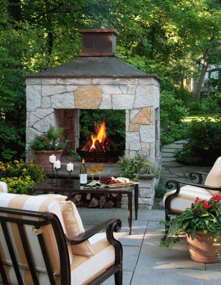 outdoor stone fireplaces - fireplace open on three sides - midwestliving.com via atticmag