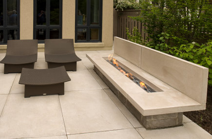 outdoor stone fireplaces - contemporary linear bench style fireplace - flickr/randolph croft via atticmag