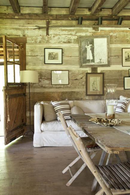 Log cabin living-dining room of an antebellum Georgia dogtrot house - gardenandgun via atticmag