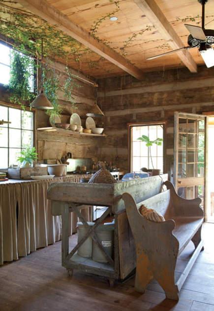 Attached log cabin converted to a kitchen of an antebellum Georgia dogtrot house - gardenandgun via atticmag