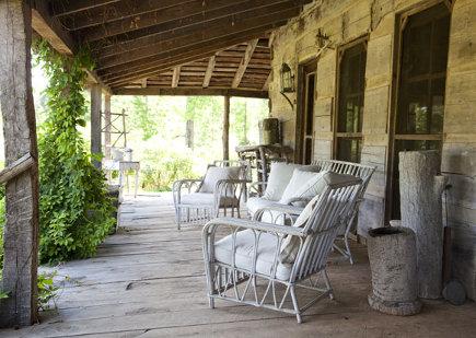 Sitting area on the porch of an antebellum Georgia dogtrot house - gardenandgun via atticmag