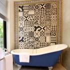 bathroom accent wall - cement tile mosaic in a border - hotel de gantes via atticmag