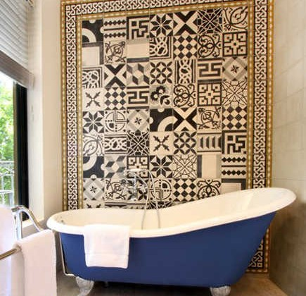 bathroom accent wall - cement tile mosaic in a border - hotel de gantes via atticmag