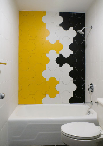 bathroom accent wall - modern jigsaw puzzle tiles on the tub wall at a Ronald McDonald house - young huh via atticmag