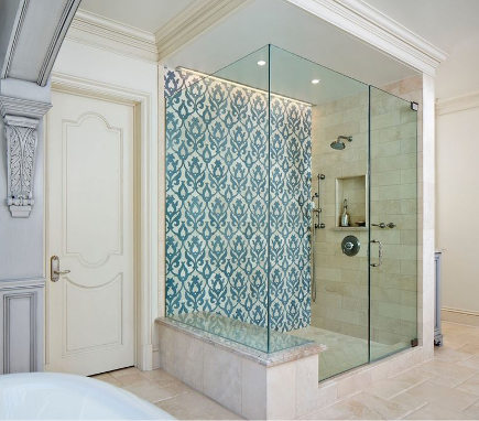 bathroom accent wall - blue and cream pomegranate damask mosaic on a shower wall - model-design via atticmag