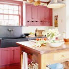 red country kitchens - red kitchen cabinets with black soapstone sink - bh&g via atticmag