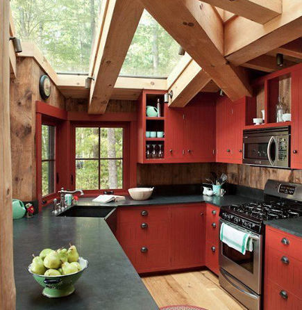 red country kitchens - red kitchen cabinets with black soapstone sink and counters - maine home design via atticmag