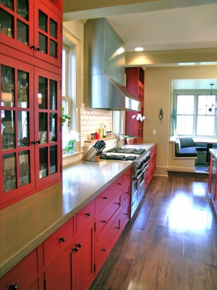 red country kitchens - colorado family kitchen with red cabinets range wall - red pepper kitchen and bath via atticmag
