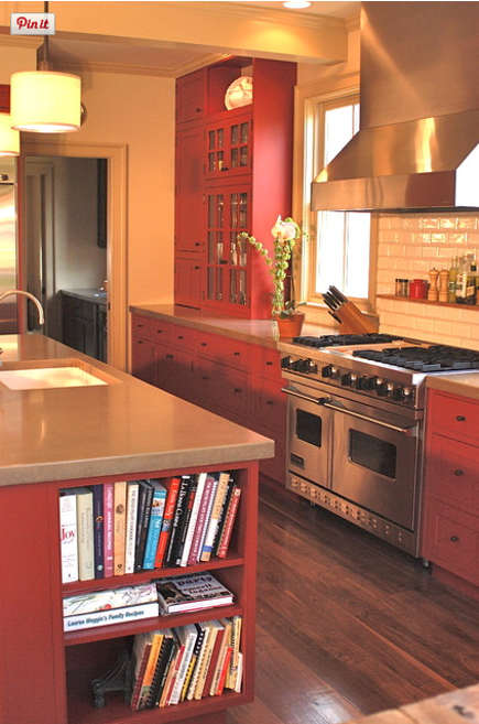 red country kitchens - colorado family kitchen with red cabinets island and range wall - red pepper kitchen and bath via atticmag