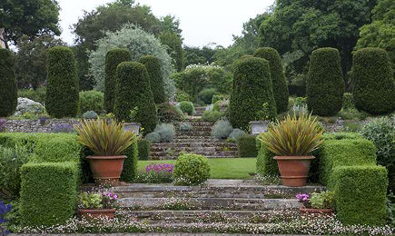 long barn gardens - stone terraces bordered by hedges - period living via atticmag