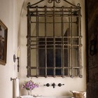 iron mirrors - repurposed ornamental iron window grilles into bathroom mirror by Eleanor Cummings Interior Design - house beautiful via atticmag