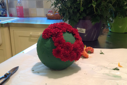 fall flower pumpkins tutorial - plunge the stem into the pphere and work your way around the ball - atticmag