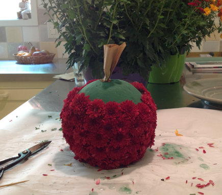fall flower pumpkins tutorial - to create a pumpkin stem, take a bit of brown paper bag and twist into a tight cylinder. Pin it to the top - atticmag