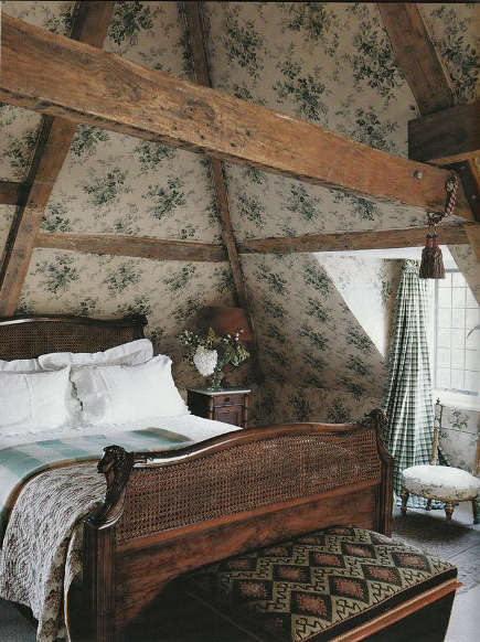 attic guest room - blue and white floral pattern on upholstered walls in an English manor house - traditional home via atticmag