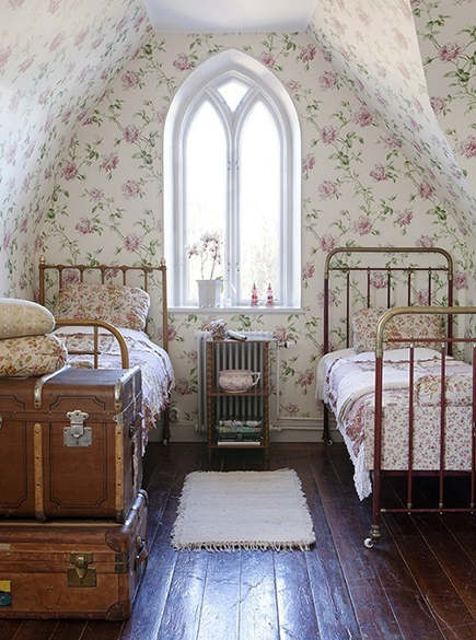 attic guest room - Gothic window and floral wall covering in a country style guest room - pinterest via atticmag