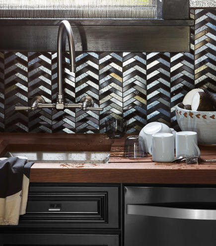 all black kitchen of the year for 2014 by Steven Miller - butler's pantry sink with Kohler Hi-Rise faucet and Ann Sacks Chrysalis Split Honeycomb mosaic in black and silver iridized tile - house beautiful via atticmag