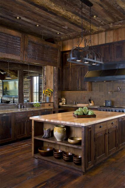contemporary ranch kitchen - dark log cabin kitchen with four sided island and open pass through over the sink - onsitemanagement via atticmag