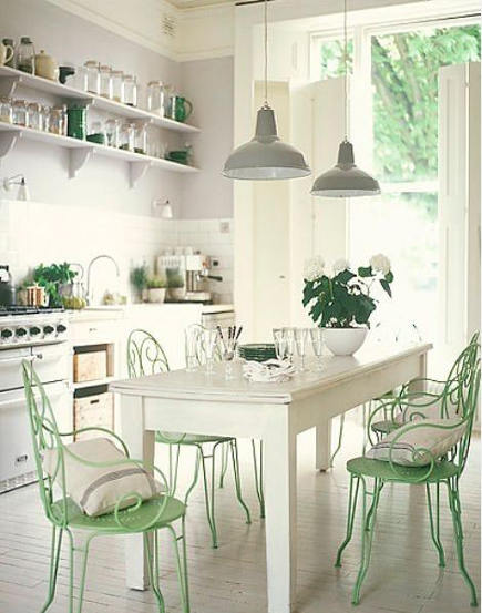 mint green accents in a kitchen are provided by the color of vintage garden chairs around the table - sweetlilmzmia via Atticmag