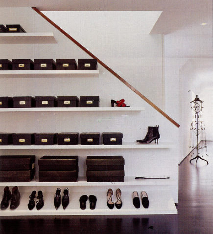 minimalist gallery style displays of shoes and leather boxes in a dressing room - - Architectural Digest via Atticmag