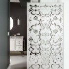 textured barn doors - pierced metal with bubble lace pattern on a bathroom entry - Dwell via Atticmag