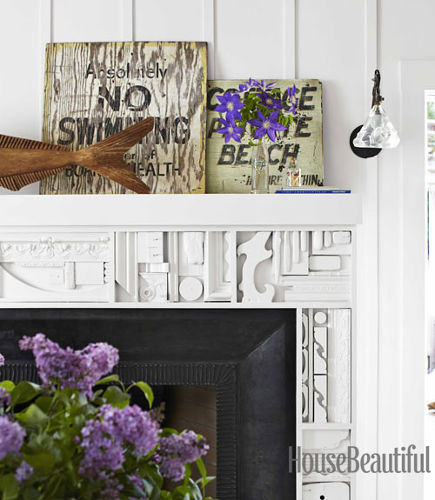 Examples of unconventional fireplace mantels include one inspired by the white sculpture of artist Louise Nevelson - House Beautiful via Atticmag