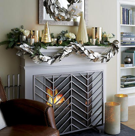 Christmas mantel - silver garland and gold mantel with accessories - Crate and Barrel via Atticmag