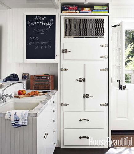 white cottage kitchen - California beach house kitchen with rebuilt vintage icebox - house beautiful via atticmag