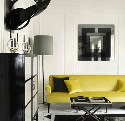 black and white decor, plus a bright yellow sofa by Colin Radcliffe - Elle Decor via Atticmag