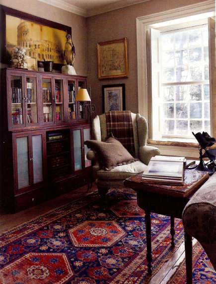 Oriental carpet colors are kept consistent in the study of a historic home - ElleDecor via Atticmag