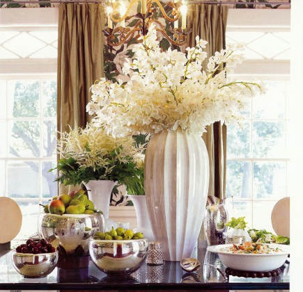 frosty holiday accessories include silver bowls and white vases filled with white flowers - Veranda via Atticmag