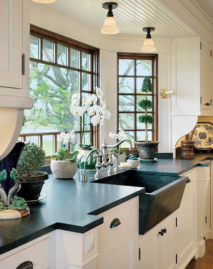 embellished farm sinks - tilt front soapstone sink in kitchen by Anthony Catalfano Interiors - bostonguide via atticmag