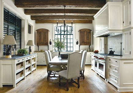 kitchen dining tables - white kitchen with trestle table and white upholstered chairs - atlanta home magazine via atticmag