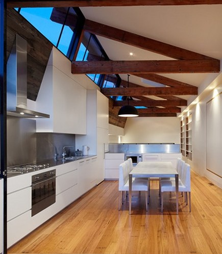 kitchen dining tables - minimalist white kitchen with table and chairs - architeam via atticmag
