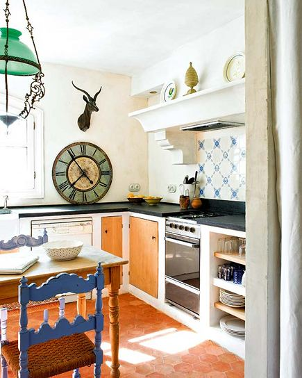 kitchen dining table - narrow turned leg wood table with paint-decorated country chairs in a European kitchen - Roses and Rust via Atticmag
