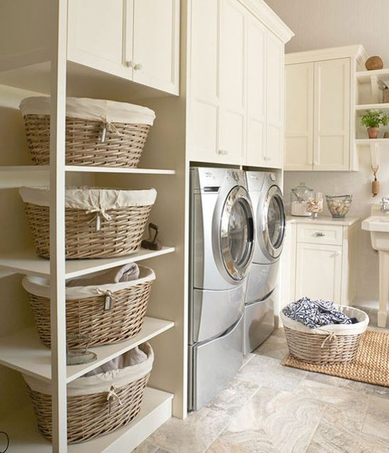 laundry room features - family laundry room with shelves for large laundry baskets - bh&g via atticmag