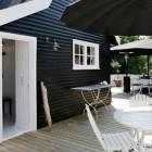 coastal cottage - black painted exterior of Danish coastal cottage in typical black and white Gilleleje regional style - femina.dk via atticmag