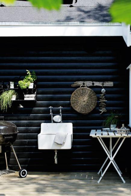 coastal cottage - outdoor sink on the black painted exterior deck of a Danish coastal cottage in Gilleleje - femina.dk via atticmag