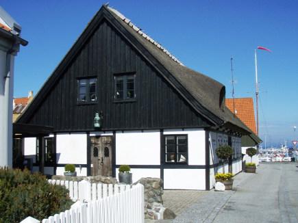 coastal cottage - typical black and white building in the Danish regional port of Gilleleje - danskkulturav.dk via atticmag
