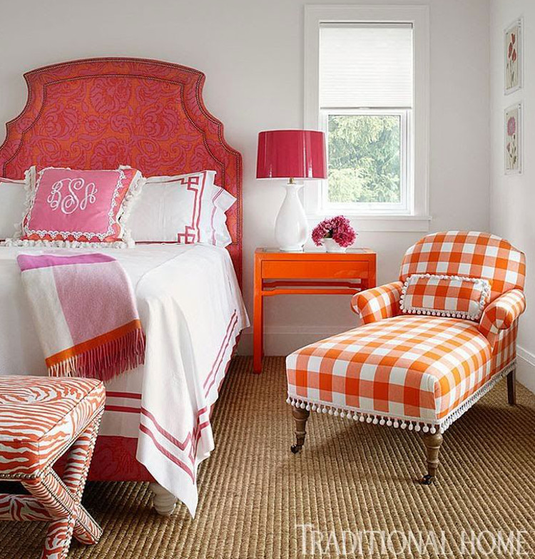mixed prints - red, orange and pink mixed prints in a guest bedroom - Traditional Home via Atticmag