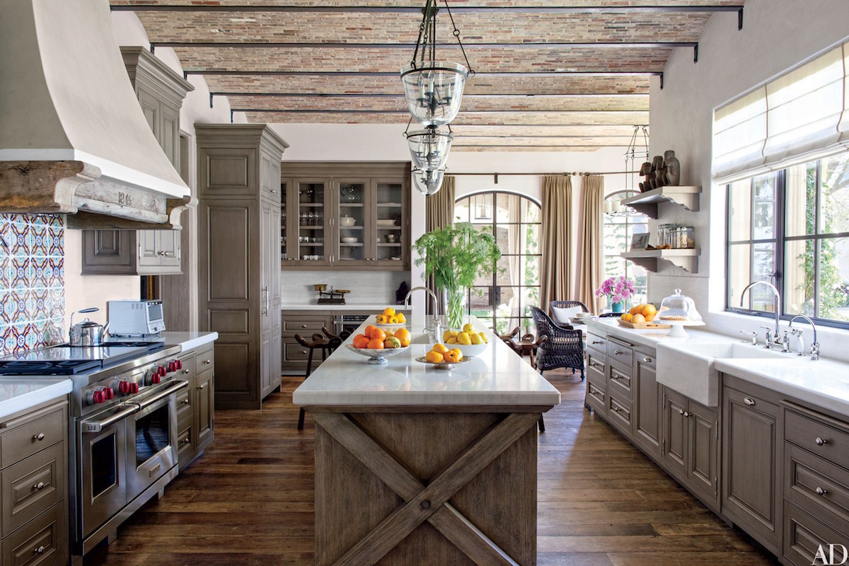 celebrity kitchens - wood tone kitchen in former home of Gisele Bunchen and Tom Brady - AD via Atticmag