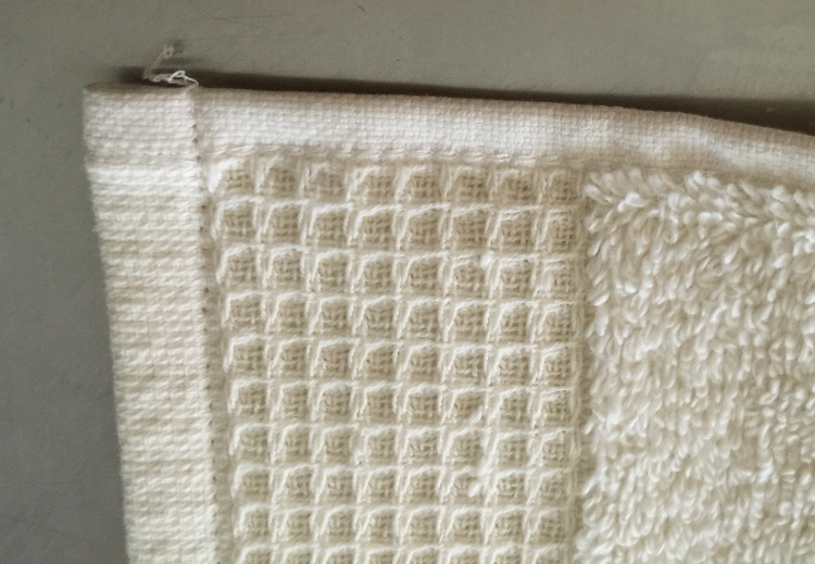 buying bath towels - single stitched corner on a hand towel sample - Atticmag