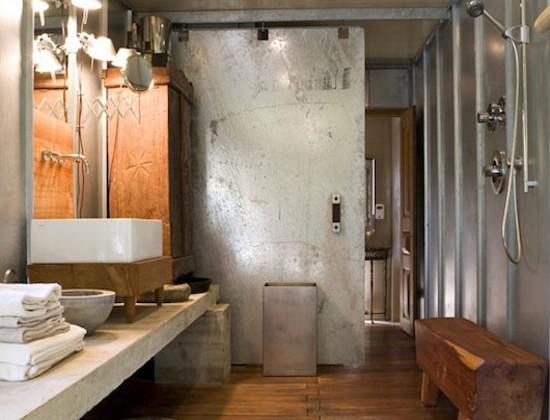 bathroom barn doors - industrial style galvanized steel bathroom barn door in a loft space - mell lawrence architects via atticmag